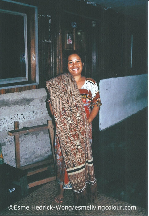Gangging, Iban master weaver and natural dyer with one of her own Puas