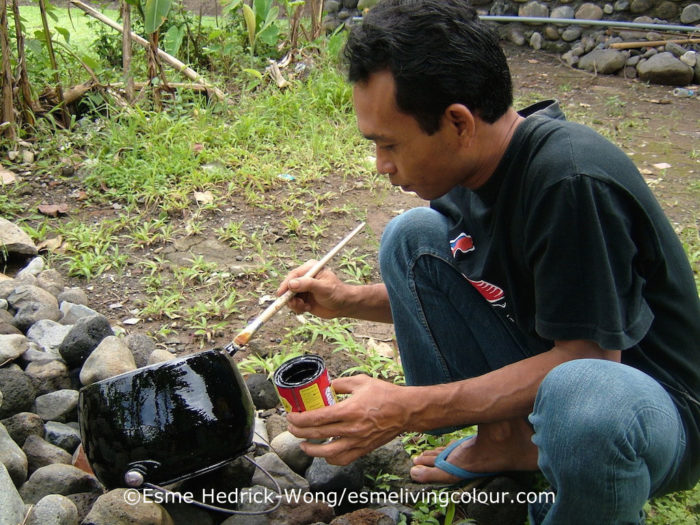 The first step in making a solar cooker is to paint the outside of your pot black
