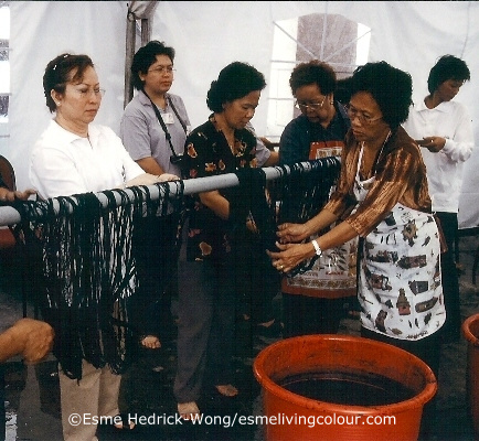 Datin Amar Margaret Linggi (far left) participating in indigo dye workshop at the Tun Jugah Foundation 2004 The late Datin Amar Margaret Linggi was a 6th generation weaver who grew up in the district of Julau Sarawak. She devoted much of her life to help preserve and keep alive the Iban textile culture in Borneo, Malaysia. As Director of Textile with the Tun Jugah Foundation in Kuching, Borneo, Malaysia, she created the Pua Gallery that displays traditional Iban textiles, some dating back 300 years. Next to the gallery is a weaving studio where the tradition of Iban Pua, (meaning blanket) weaving is practiced today. Datin Margaret was remarkable for her ability to organize large natural dye and weaving workshops, bringing together traditional Iban dyers and weavers from all over Sarawak, many coming from remote longhouses deep in the rainforest jungle who had to travel for days to reach Kuching. Datin Margaret will be sorely missed by many, Iban weavers as well as textile lovers everywhere. Her book, 'Ties That Bind' - Iban Ikat Weaving, documenting seventy Pua blankets and giving in-depth descriptions of the dye and weaving process is invaluable and her work to revive this art form is set to continue with the next generation of weavers